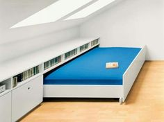 This is genius! Perfect for a guest bedroom in the attic. Use the space for your own stuff (workout equipment, space to do jigsaws) then pull the bed out when you have guests. - My Interior Design Ideas Attic Rooms, Attic Spaces, Small Spaces, Attic Bathroom, Small Attic Room, Barn Bathroom, Attic Playroom, Attic Apartment, Apartment Therapy