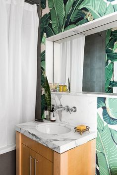 Go inside this modern Brooklyn apartment filled with exotically-sourced finds and bold color. Get inspired by the daring paint color paintings and learn more ab