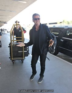 Pierce Brosnan At Los Angeles International Airport (LAX) http://icelebz.com/events/pierce_brosnan_at_los_angeles_international_airport_lax_/photo1.html