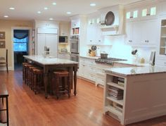 nice cabinets to the ceiling....love that island!