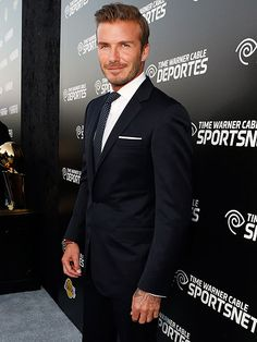 We all love Becks when he's shirtless, but David Beckham sure suits up nicely! http://www.people.com/people/gallery/0,,20635148,00.html#21222009