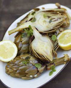 Artichokes with lemon and garlic recipe http://www.underthealmondtree.com/2013/04/15/artichokes-with-lemon-garlic/