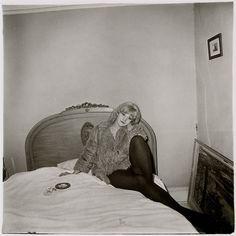 Girl in a Coat Lying on her Bed, N.Y.C. by Diane Arbus on artnet Auctions