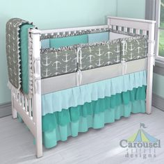 Crib bedding in Solid Teal, Aqua Dim Dots, Ash Gray Anchors, Silver Gray Linen, Solid Emerald Turquoise. Created using the Nursery Designer® by Carousel Designs where you mix and match from hundreds of fabrics to create your own unique baby bedding. #carouseldesigns