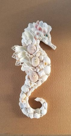 Coastal decor, beach art and furniture. You can improve the natural beauty in your home with splashes of white, as well as beach house decorating ideas. Seahorse Art, Seashell Art, Seashell Crafts, Beach Crafts, Seahorses, Driftwood Seahorse, Seashell Bathroom, Seashell Projects, Driftwood Projects