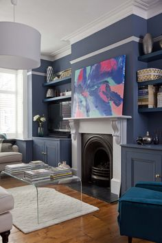 Home of Clare Elise Interiors. Art by Nicky Kriss. Walls Juniper Ash by Little G… Home of Clare Elise Interiors. Art by Nicky Kriss. Walls Juniper Ash by Little Greene Paint Company Brown And Blue Living Room, Dark Blue Living Room, Dark Blue Lounge, Dark Blue Walls, Dark Painted Walls, Living Room Paint, New Living Room, Living Room Decor, Dining Room