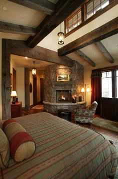 The moss rock fireplace adds a cozy touch to this master bedroom and the clerestory adds interest and light to the room. Description from interiordesignpro.org. I searched for this on bing.com/images