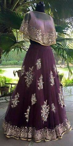 Check out this post - The latest design we made at our store on cape, lehenga created by Ekta Sobti and top similar posts on cape, lehenga, trendy products and pictures by celebrities and other users on Roposo. Indian Gowns, Indian Attire, Pakistani Dresses, Indian Wear, Eid Dresses, Indian Wedding Outfits, Bridal Outfits, Indian Outfits, Eid Outfits