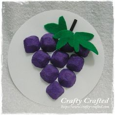 Egg carton grapes.  Could hide something under one and make it into a game.