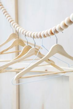 Fuers Heim Snake clothes rail - This hanging wooden bead garland was designed as clothes line or wardrobe rail. Handmade in Germany from 40 beech wood balls. Clothes Rail, Hanging Clothes, Clothes Line, Diy Clothes Rack, Clothes Stand, Clothes Hangers, Do It Yourself Inspiration, Wardrobe Solutions, Diy Wardrobe