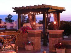 an outdoor living space by Aspen Outdoor Designs, Inc.; featuring a cedar pergola