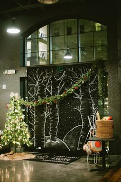 (chalkboard look...draped with Christmas garlands)