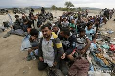 Refugees wait to cross Greece's border with FYRO Macedonia, near Idomeni, Sept 7, 2015. Photo/Yannis Behrakis