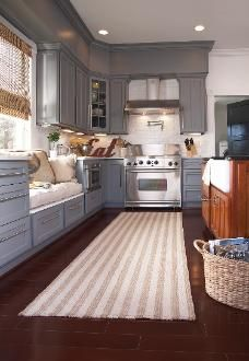 kitchen Rug.... open kitchen up to dining room with window seat under window, as bench seating for dining room table