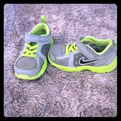 Kids Nike sneakers Gently used grey and lime green Nike kids sneakers with Velcro closure. Size 8Child Nike Shoes Sneakers