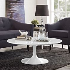 """Lippa 48"""" Oval Shaped Wood Top Coffee Table in White"""