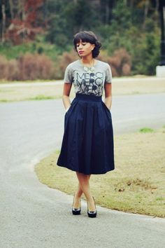 Grey stylish english lyrics printed haf sleeveless blouse with dark navy blue cute skirt and black shining high heels pumps