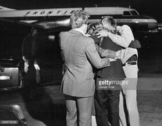 Frontier Airlines stewardess Diane Lord back to camera U hugged by friends at Stapleton International Airport