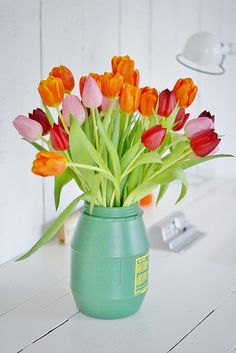 orange, pink & red tulips by wood & wool stool, via Flickr I love Tulips!