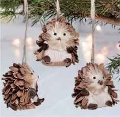 Pine Cone Hedgehog Ornaments. There's no tutorial for this, but you could make your own by slicing a pine cone in half and drawing little faces and paws with a Sharpie.