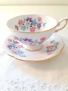 English Royal Standard Fine Bone China Teacup and Saucer in White with Floral Pattern and rimmed with Gold