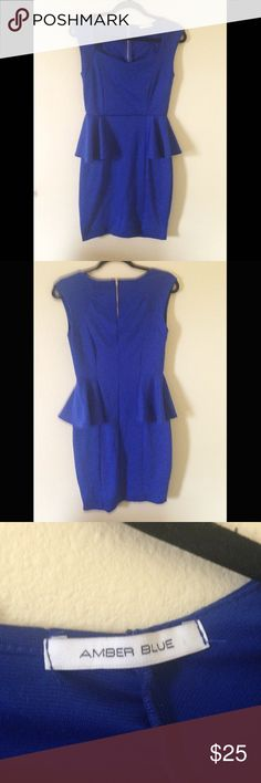 Gorgeous royal blue peplum dress Royal blue peplum dress. Never worn, slightly too small for me. Size large but runs a little small in the chest. Zipper in the back, stretchy material so very flattering! Amber Blue Dresses Mini