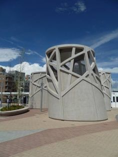 These 'towers' are actually for air intake and bus fume exhaust, cannily disguised as pieces of public art.