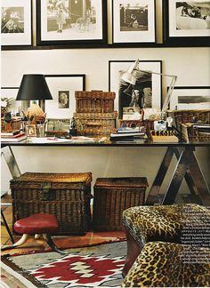 Love the black and white photos, the wicker baskets and most of all the leopard print stools...Grrrrrr.