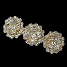"Simple and charming, this gold hair barrette features three lovely flowers in radiant clear rhinestones encrusted on a gold plating. Perfect for an elegant affair or to give a simple outfit an elegant touch.  3 1/4"" x 1"""