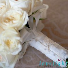 Ivory and cream lace adorn this bridal bouquet with pale pink blush roses for a chic yet modern romantic vintage feel