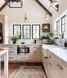 modern farmhouse kitchen brown ceiling wood beams black modern chandelier white cabinets white marble black windows gold light fixtures built in microwave colorful kitchen rug Home Decor Kitchen, Kitchen Interior, New Kitchen, Home Interior Design, Kitchen White, Kitchen Wood, Kitchen Rug, Kitchen Modern, Kitchen Images