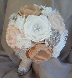 Large vintage fabric bouquet - coral shades, ivory, tan and champagne loaded with crystals and brooches - deposit listing. $100.00, via Etsy.
