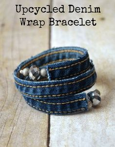 Make something old into something new with this upcycled Denim DIY Wrap Bracelet tutorial. Learn how to make a bracelet out of the seams of an old pair of jeans and rock your own memory wire wrap bracelet! Making Jewelry For Beginners, Jewelry Making, Denim Bracelet, Zipper Bracelet, Fabric Bracelets, Wrap Bracelets, Kleidung Design, Denim Ideas, Denim Crafts