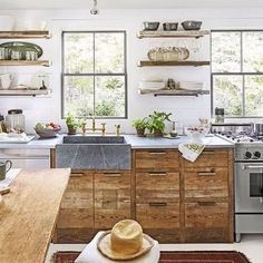 Another view of our Maine kitchen featured today on the @witanddelight_ blog. Thanks for the feature! @maxkimbee @countrylivingmag @rockymounthardware @christinawressell #newportbrass #southwestharbor #maine #instadesign #cottage @reclaimeddesignworks