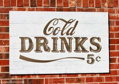 Cold Drinks Sign Great Tutorial on aging wood, applying vinyl and then painting for a vintage look.