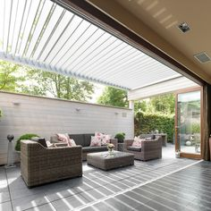 An IQ Lux patio roof was used in this contemporary home renovation to extend living spaces further into the garden. The automated louvre roof sits over the large patio area jointly supported by the building, leg posts and the boundary wall. Diy Pergola, Gazebo, Pergola Ideas, Louvered Pergola, Outdoor Garden Furniture, Outdoor Decor, Outdoor Shelters, Outdoor Living Rooms, Living Spaces