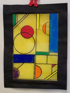 4th GRADE--Wright Stained Glass --- Black sharpies and paint on the vellum paper. Then the board is cut from black constuction paper