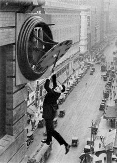 "Harold Lloyd in ""Safety Last!"" (1923).  Photo: Harold Lloyd and Wesley Stout  He did all his own stunts - no safety nets here!"