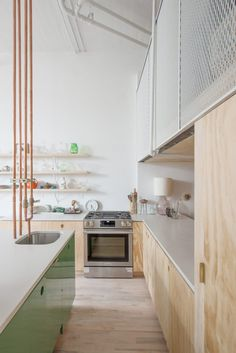 New Affiliates renovates Bed-Stuy Loft with plywood mezzanine and rough materials