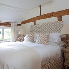 Bedroom Ideas: Exposed Timbers Bedroom with Soft Brown Pattern Headboard also Clean Line Cushions plus Soft Brown Throw Pillows and White Curtain
