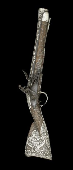An Ottoman silverwire-inlaid flint-lock Blunderbuss Turkey, 19th Century. | © Bonhams 2001-2014