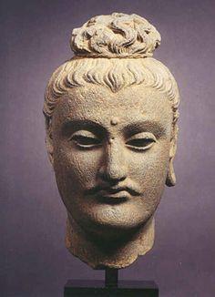 Buddha Head Pakistan; Ancient Region of Gandhara 2nd/3rd century AD schist Height: 25.4 cm (10 ins)