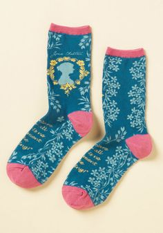 An aspiring novelist yourself, you look up to the great Jane Austen while you look down at these literary crew socks! Their blue knit boasts floral vines, a yellow-framed silhouette of the writer herself, pink trim, and a reading-centric quote that you live by as you snuggle up with a book.
