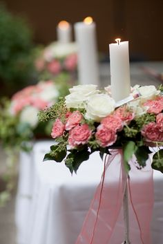 Gorgeous!  altar wedding flowers with roses, coralle, ivy and candles