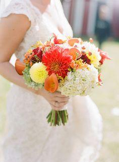 Orange dahlia bouquet | Brides.com