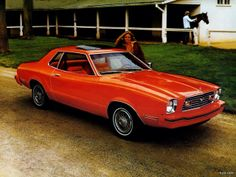 1977 Mustang II coupe with added pop-open sun roof and wire wheel covers.
