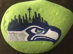 Seattle Seahawk Logo with Space Needle Skyline Painted Rock &