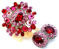 """High-end Fashion Vintage Jewelry - This is a """"Made In Austria"""" fuschia, pale pink and red rhinestone pin and clip on earring set. It is silver tone with all prong set rhinestones. There's just so much"""