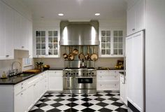 love this black and white tile floor in kitchen