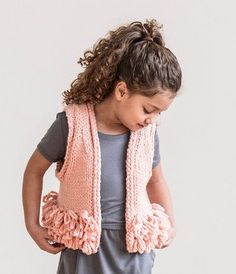The Lucky Loop Vest: an advanced beginner knit, with the opportunity tolearn a new skill with the fringy-loop detail. This piece is a quick knit with many great color options.